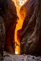 Australia, Western Australia, Kimberley, Purnululu National Park, Bungle Bungle, man climbing at Echidna Chasm