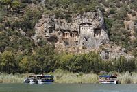 Turkey, Dalyan, Tourboats at Lycian Rock Tombs of Kaunos