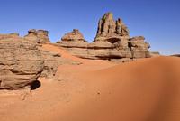 Algeria, Sahara, Tassili N'Ajjer National Park, Tadrart, sandstone rock towers in the sand dunes of Tin Merzouga