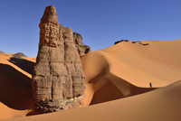 Algeria, Tassili n' Ajjer, Tadrart, Sahara, Tassili n' Ajjer National Park, view to sand dunes and rocks of Moul Nag with people