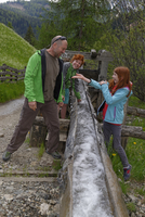 Italy, Alto Adige, happy family on hiking trail in the Campill valley