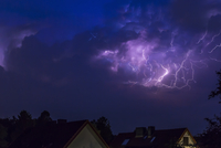 Germany, Hamburg, dramatic night sky at heavy thunderstorm