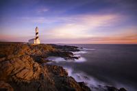 Spain, Balearic Islands, Menorca, Cap de Cavalleria, lighthouse at sunrise