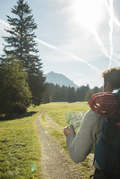 Austria, Tyrol, Tannheimer Tal, young  hiker watching hiking map