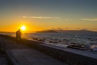 Greece, Crete, Man enjoying the sunset in Chania