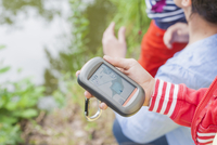 Germany, Girl holding GPS