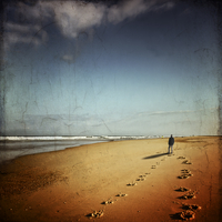 France, Contis-Plage, man walking on the beach looking to the sea