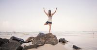 Sri Lanka, Kabalana, young woman practicing yoga on the beach