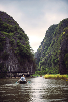 Vietnam, Tam Coc, River view in the dim light of dusk at Ninh Binh