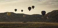 Turkey, Anatolia, Cappadocia, hot air ballons near Goereme at sunrise