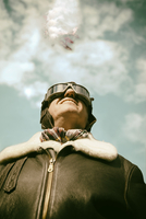 Acrobatics pilot and flying biplane in the background 20025331632| 写真素材・ストックフォト・画像・イラスト素材|アマナイメージズ