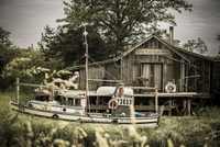 Canada, British Columbia, Finn Slough, fishing boat and wooden house at Fraser River