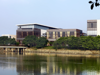 View of modern building from across lake