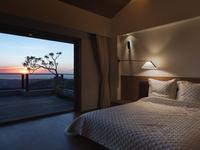 Modern bedroom at sunset