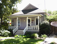Front exterior purple cottage with white trim