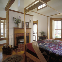 BEDROOMS - Small roof top cottage, shaker style interior, four poster bed, quilt,  fireplace with brick hearth, antique mantel,