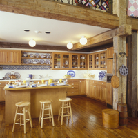 KITCHEN - Pine kitchen. Island with breakfast dishes. Blue accents, contemporary in a log home, wood floors, ball ceiling lights 20025340861| 写真素材・ストックフォト・画像・イラスト素材|アマナイメージズ