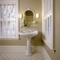 BATHROOMS: White pedestal sink, mustard painted walls, white trim at windows with wooden shutters, tile floor hexagon pattern NO 20025340866| 写真素材・ストックフォト・画像・イラスト素材|アマナイメージズ