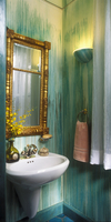 BATHROOMS: Small half bath, teal and aqua dragged paint effects, antique gilded neo-classical 1840's mirror, white suspended ped