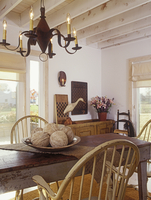 DINING AREA: Antique table and chairs. White country decor, tin chandelier, exposed beams, simple shades, distressed farm table,