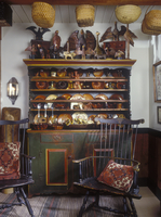 COLLECTION DISPLAYS -  In keeping room collection of redware displayed on circa 1800's Pennsylvania German cupboard, antique Win