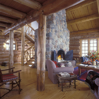 FIREPLACES: Log house with stone fireplace, log columns, stairway, open cathedral ceiling, twig furniture, tulips, area rug, cas 20025340886| 写真素材・ストックフォト・画像・イラスト素材|アマナイメージズ