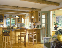 KITCHENS - Country, log beamed ceiling, pine cabinets, pine floors, penisula and center island, sage green door