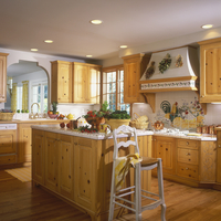 KITCHEN - Natural pine floors and cabinets. White ceramic tile counter tops and backspalsh, range hood withtile and wood, French