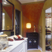 BATHROOMS: Red and tan walls. Oriental theme and accents. Faux paint on walls, antique oriental chest of drawers, white counter. 20025340930| 写真素材・ストックフォト・画像・イラスト素材|アマナイメージズ
