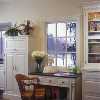 KITCHENS - Desk area sits between cereal pantry and antique china cabinet. Cabinets are painted 'Linen White.' Cookbooks shelf u