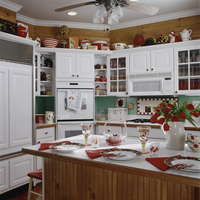 KITCHEN ; cherry theme, with white cabinets & counter tops, natural wood stained wainscot , with view to oven & fridge, cherry m