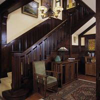 Stairways: Arts & Crafts style, rich wood, the atairs balustrade design is picked up in a table& chair at foot of stairs. Authen