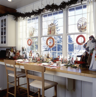 CHRISTMAS: Eating area, wood counter tops, looking out window, santa collection and antique Christmas decorations,