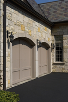 GARAGES: Stone home,arched garage doors, lighting, slate roof