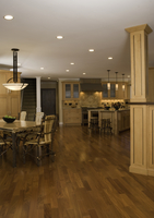 KITCHEN: expansive wood floors connect the twig dining table and chairs, with the kitchen area, large island with Craftsman styl