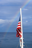 American flag with rainbow in the background