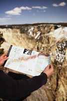 Close-up of a person's hand holding a map, Yellowstone National Park, Wyoming, USA