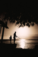 Silhouette of a person fishing in a lake, Lake Mead, Utah, USA