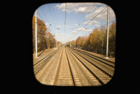 Railroad track viewed through a train window