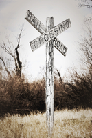 Railroad crossing sign on a field Montana, USA