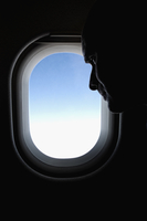Man near a window in an airplane