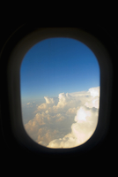 Clouds viewed through a window of an airplane