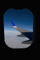 Wing of an airplane viewed through a window