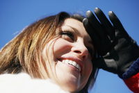 Low angle view of a young woman shielding her eyes