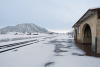 Railroad tracks covered with snow