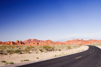 Road passing through an arid landscape, Las Vegas, Nevada, USA