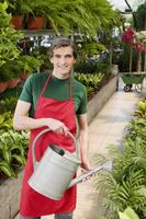 Man watering plants 20025341814| 写真素材・ストックフォト・画像・イラスト素材|アマナイメージズ