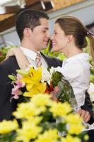 Couple romancing at a flower shop 20025341847| 写真素材・ストックフォト・画像・イラスト素材|アマナイメージズ