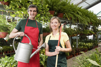 Couple standing in a greenhouse