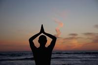 Man practicing yoga on the beach,Santa Monica,Los Angeles County,California,USA